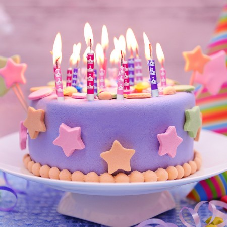 Delicious birthday cake on table on light background